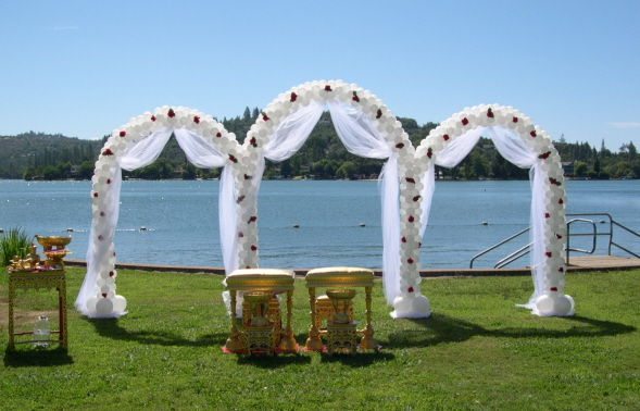 Triple Arch This gorgeous triple wedding arch will make a beautiful backdrop